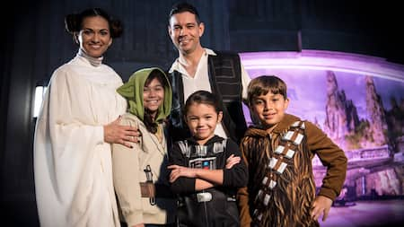 A family dressed in Star Wars costumes