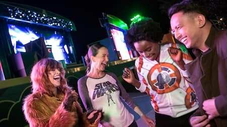 A group of friends wearing Star Wars attire dance together