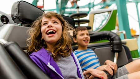 A boy and a girl on a roller coaster