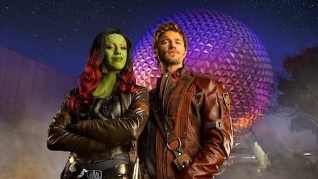 Star Lord and Gamora stand in front of Spaceship Earth