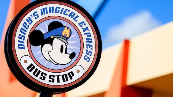 Round bus-stop sign with Mickey's face for Disney's Magical Express