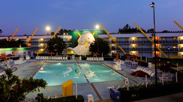A view at dusk of Duck Pond pool, inspired by the Disney film The Mighty Ducks, with an iconic giant hockey mask shaped like a duck's bill