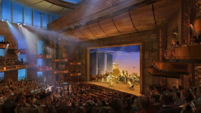 Realistic rendering of stage production at a large theater auditorium with thousands in audience