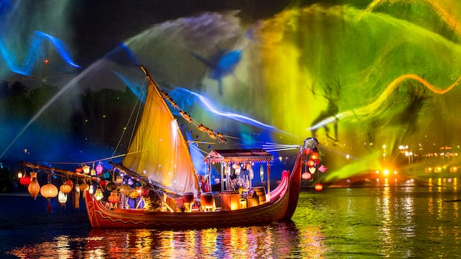 A boat floating on water under a colorful display of animals