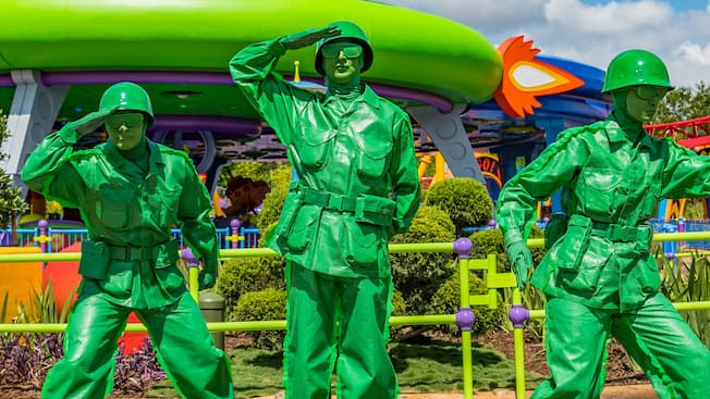 The Green Army Patrol from the Toy Story films poses in front of a spaceship