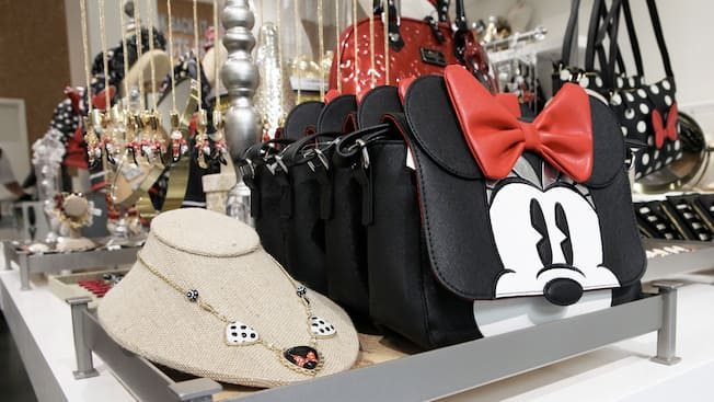 Display racks featuring Minnie Mouse themed necklaces and clutches