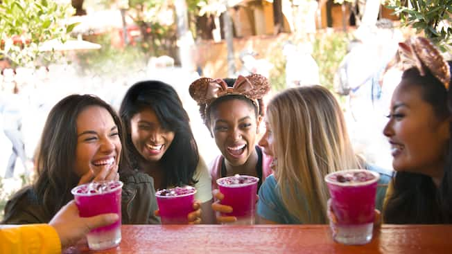 Drinks are handed out to a happy group of young adult Guests