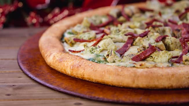 Pizza topped with pesto chicken