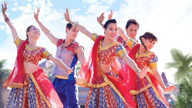 A group of Indian dancers perform in their traditional garb