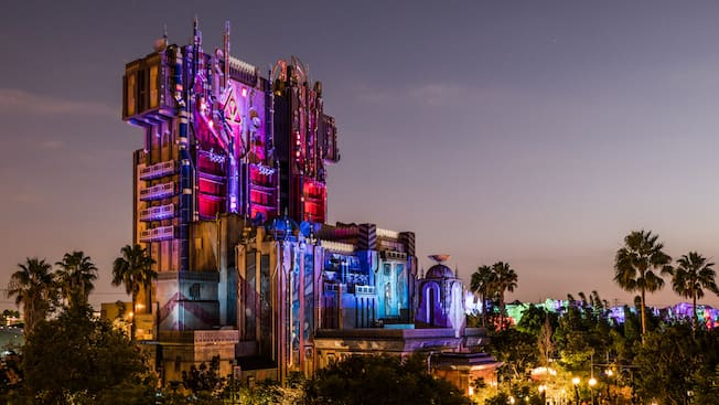 Guardians of the Galaxy, Monsters After Dark, a futuristic, dystopian skyscraper at night