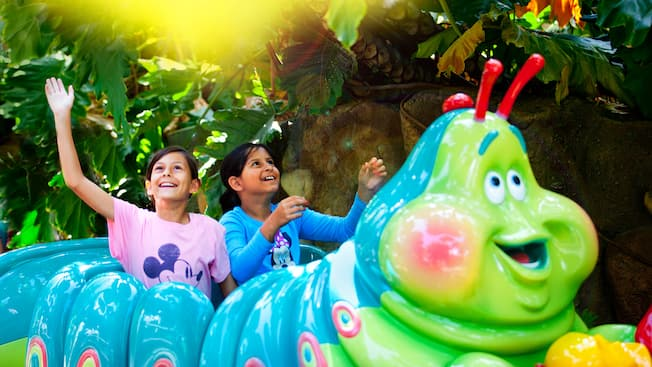 Two girls are delighted by the scents and sights from Heimlich's Chew Chew Train