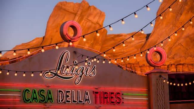 A mother and daughter are delighted to ride Luigi's Flying Tires at Cars Land