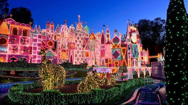 the its a small world attraction at disneyland park decorated for the holidays