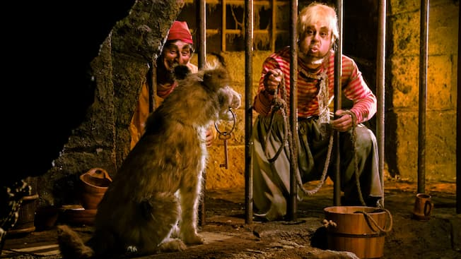 Dangling from a dog's mouth is the key that would free jailed pirates of the Caribbean