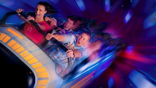 A group of teens ride Space Mountain