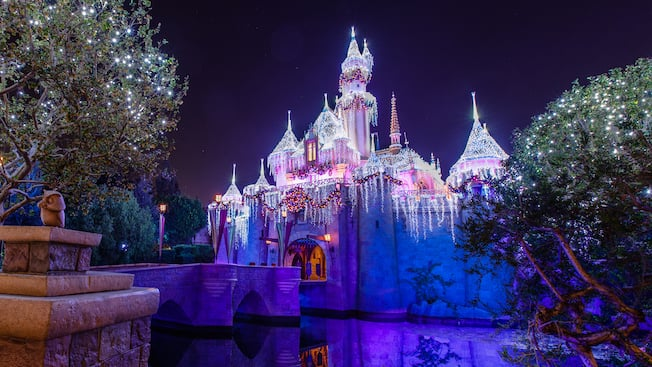 Sleeping Beauty's Winter castle decorated for the holidays and illuminated at night