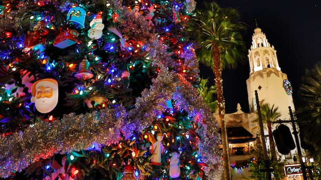 a decorated christmas tree near a cathedral and palm trees - Christmas Tree Lighting