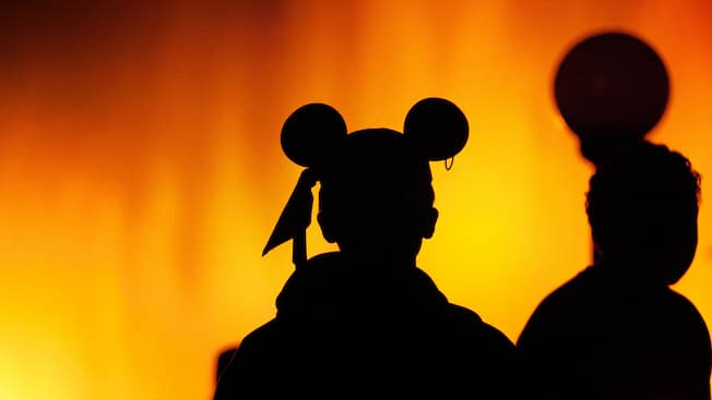 Children watching World of Color wearing Mickey ears