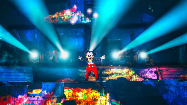 Lights project from Mickey's fingertips as he performs onstage during the Fantasmic! nighttime spectacular
