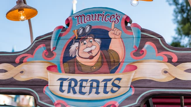 A colourful wooden sign at Fantasy Faire reads, 'Maurice's Treats'