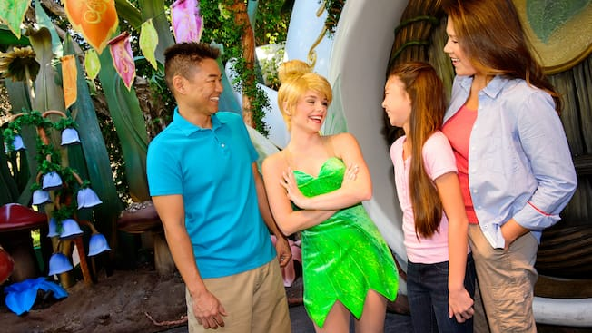 Meet tinker bell at pixie hollow disneyland resort tinker bell greets a family in front of her woodland home in pixie hollow disneyland park m4hsunfo