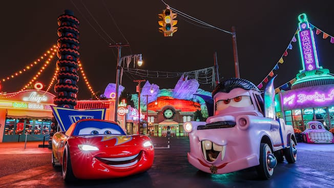 Lightning McQueen poses next to Mater, who is dressed up like Count Dracula at Cars Land