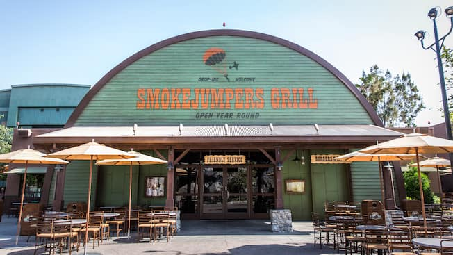 Exterior of Smokejumpers Grill with tables, chairs and umbrellas at Disney California Adventure Park