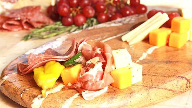 Gourmet meat and cheese plate with fresh fruit at Sonoma Terrace in Disney California Adventure Park