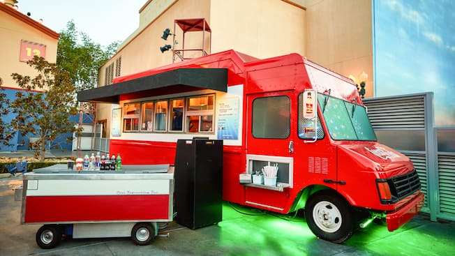 The Studio Catering Co snack truck with a Coca Cola beverage cart stationed in front
