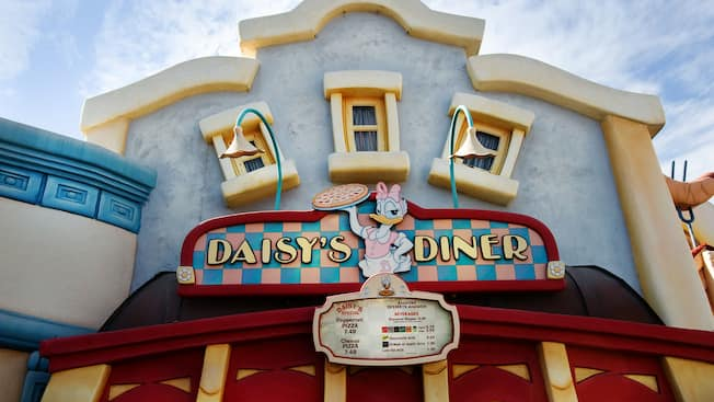 Daisyâ S Diner Sign Above A Menu Board Outside The Quick Service Restaurant