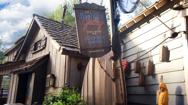 Sign: Harbour Galley Come Ashore for Dockside Dining at Disneyland Park