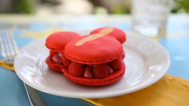 Mickey shaped raspberry macaron on a plate