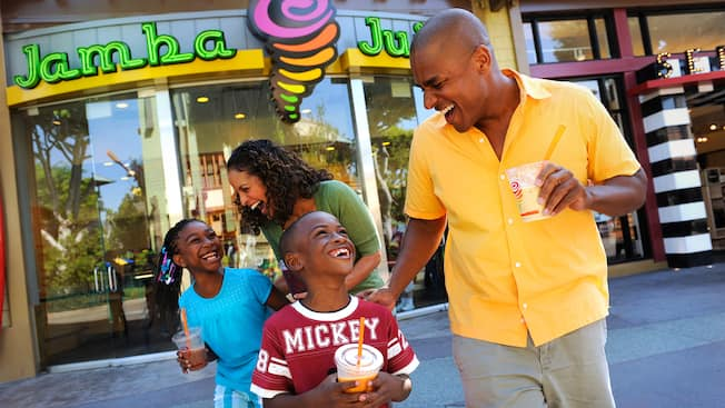 A family enjoys Jamba Juice smoothies at Downtown Disney District in the Disneyland Resort