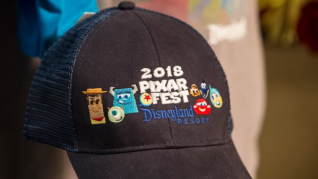 A Pixar Fest 2018 hat featuring characters like Woody, Nemo, Sully and more