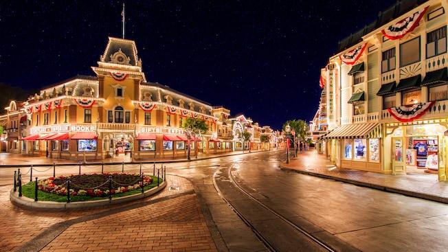 A sea of stars filling the sky as vibrant lights illuminate Main Street, U.S.A. at Disneyland Park