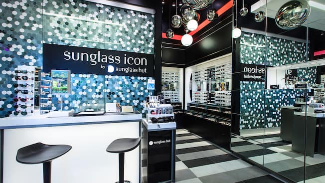 The Sunglass Icon counter sits beneath disco balls