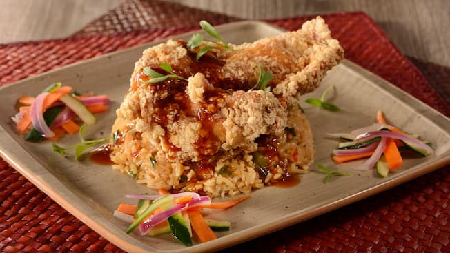 Fried chicken paired with onions, zucchini, carrots and rice
