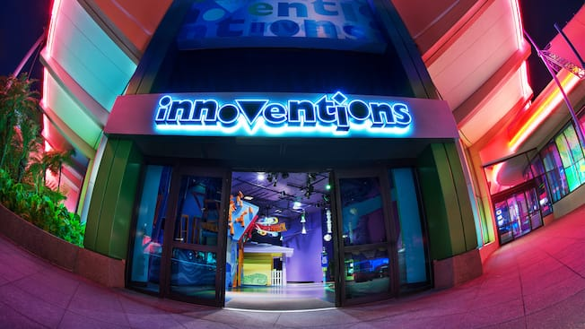 A large lit sign that says 'Innoventions' hangs over an open sliding glass door