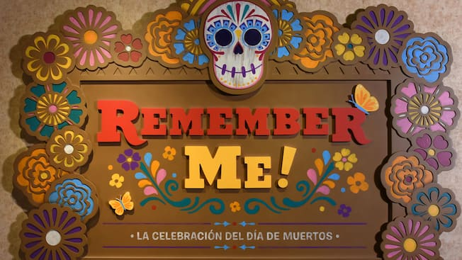 A sign that reads Remember Me La Celebracion Del Dia De Muertos