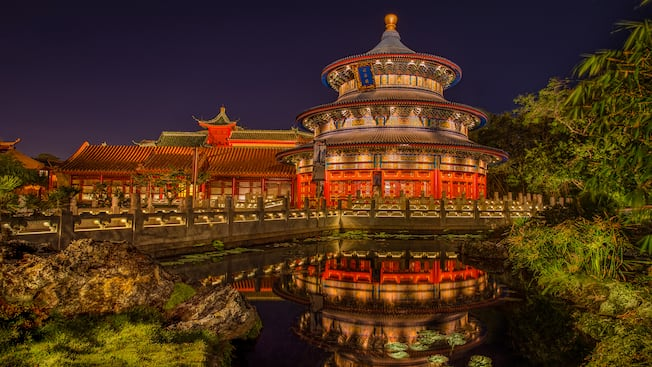 Nighttime view of the Temple of Heaven and its reflection in a pond at the China Pavilion at Epcot