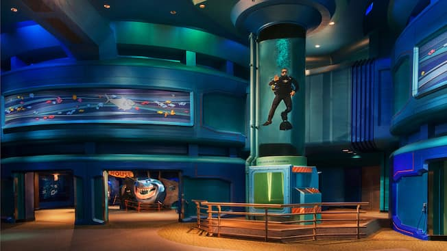 The main room at SeaBase with a SCUBA diver and Bruce's Sub House in the background