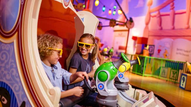 Kids in 3D glasses on the Toy Story Mania! attraction at Disney's Hollywood Studios