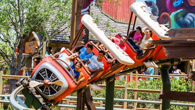 Guests delight in riding The Barnstormer rollercoaster attraction in Fantasyland
