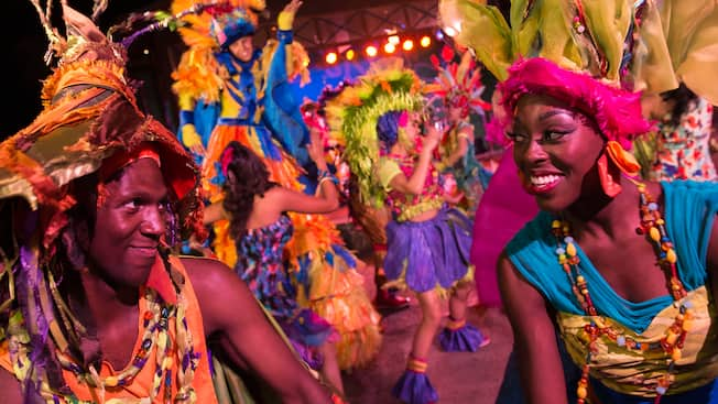 Performers dressed in tribal inspired costumes at the nightly Discovery Island Carnival at Disney's Animal Kingdom park