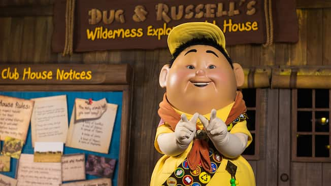 "Russell from Disney•Pixar's ""Up"" awaits Guests at a Character Greeting experience on Discovery Island"