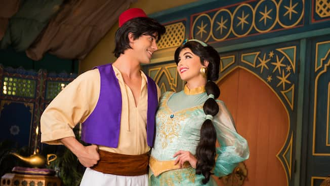 Meet aladdin characters in adventureland walt disney world resort meet characters from aladdin in adventureland aladdin and disney princess jasmine stand arm in arm smile and gaze into each others m4hsunfo