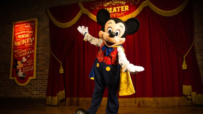 Master Magician Mickey stands onstage at Town Square Theater on Main Street, U.S.A.