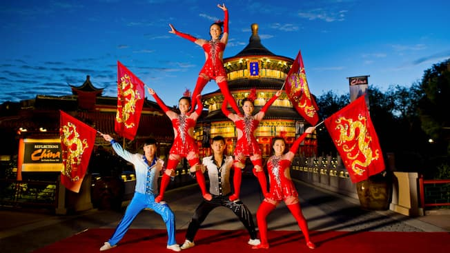 Members of the troupe Jeweled Dragon Acrobats perform a pyramid in the China Pavilion