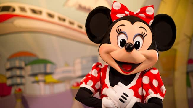 Mickey Mouse awaiting Guests during a Character Greeting experience at the Disney theme parks