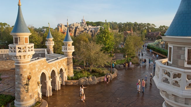 A view from Cinderella Castle of Guests walking down the streets of Magic Kingdom park